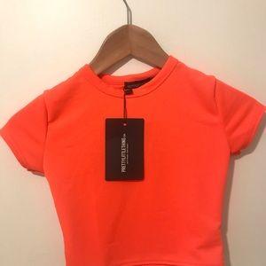 PrettyLittleThing Tops - Basic Neon Orange Short Sleeve Crop T Shirt